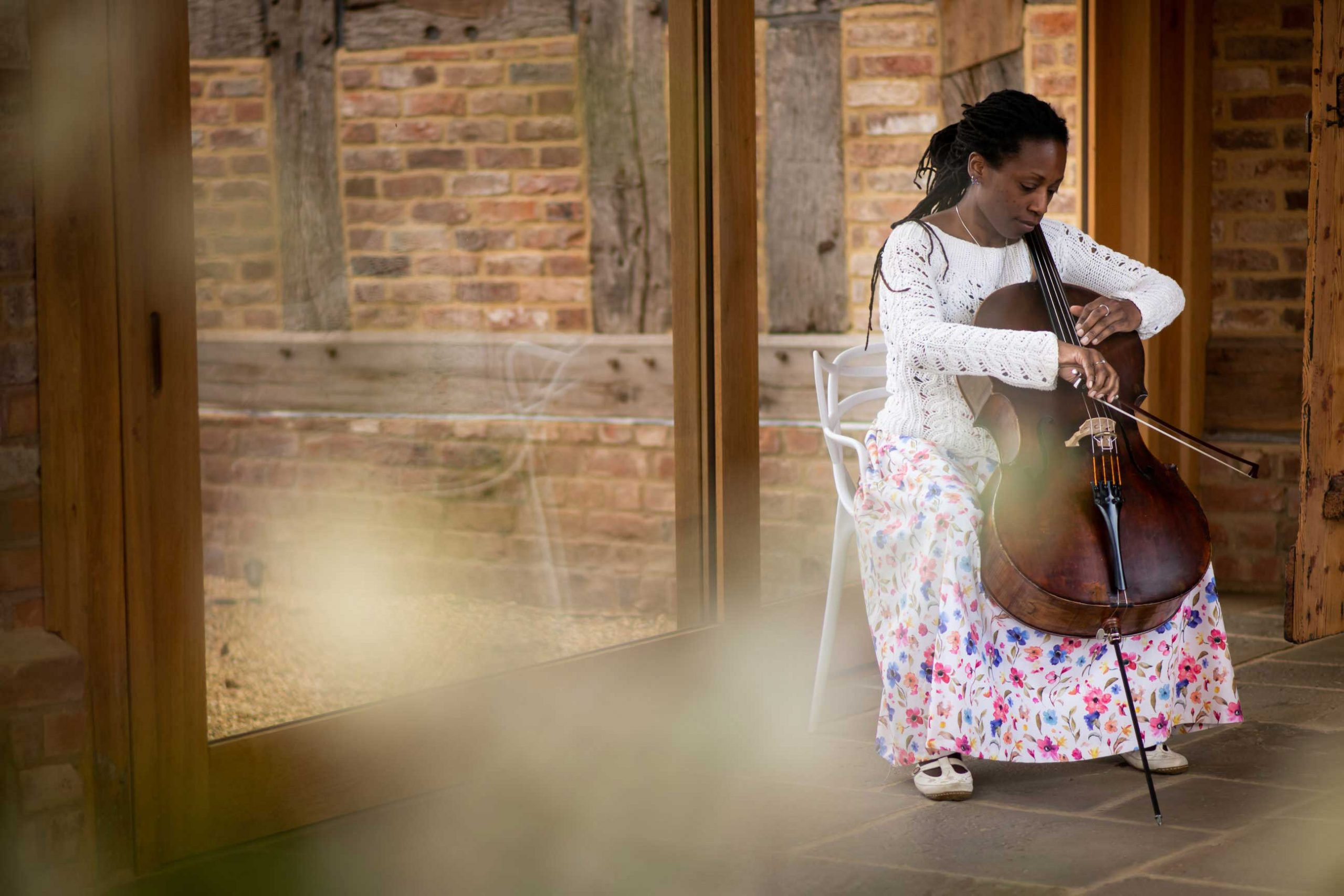 Jay Emme UK Wedding Cellist playing cello at wedding venue Barns and Yard in Worcester